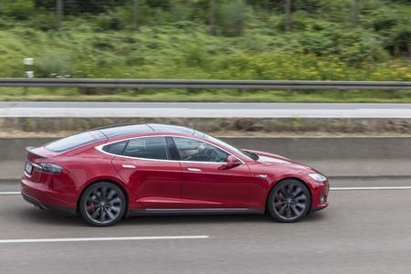 FRANKFURT, GERMANY - JULY 12, 2016: Tesla Model S luxury electric sedan on the highway in Germany