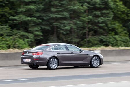 highway 6: FRANKFURT, GERMANY - JULY 12, 2016: BMW 6 Series 4 door coupe  driving on the highway in Germany
