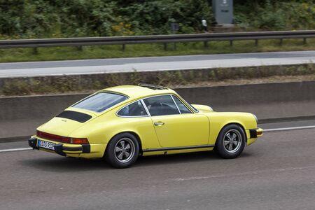 sportscar: FRANKFURT, GERMANY - JULY 12, 2016: Old Porsche 911 sportscar driving on the highway in Germany