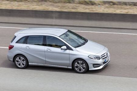 12 class: FRANKFURT, GERMANY - JULY 12, 2016: Mercedes Benz B Class compact luxury van on the highway in Germany