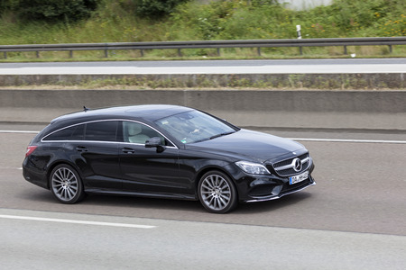 benz: FRANKFURT, GERMANY - JULY 12, 2016: Mercedes Benz CLA Shooting Brake luxury estate car driving on the highway in Germany