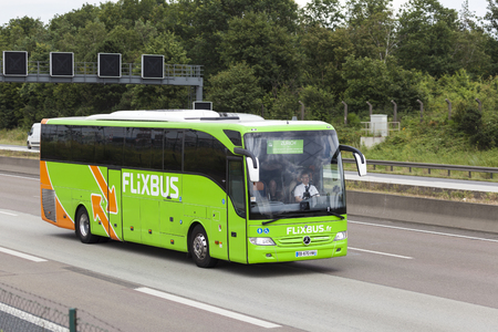 long distance: FRANKFURT, GERMANY - JULY 12, 2016: Green Flixbus european long distance coach on the highway in Germany