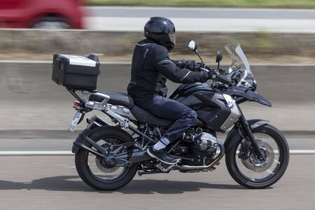 motorcyclist: FRANKFURT, GERMANY - JULY 12, 2016: Motorcyclist on the BMW R1200 GS motorcycle driving on the highway in Germany Editorial