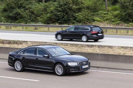 FRANKFURT, GERMANY - JULY 12, 2016: Black Audi A8 Quattro luxury sedan on the highway in Germany