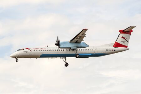 8 12: FRANKFURT, GERMANY - JULY 12, 2016: Austrian Airlines Bombardier Dash 8  landing at the Frankfurt Main international airport
