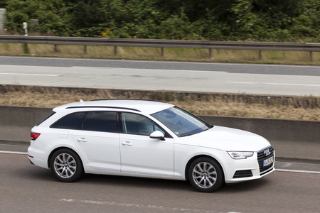 FRANKFURT, GERMANY - JULY 12, 2016: White Audi A6 Estate on the highway in Germany