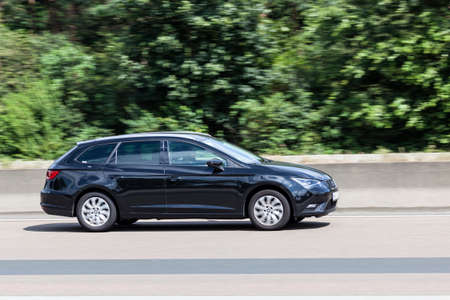 FRANKFURT, GERMANY - JULY 12, 2016: Seat Leon ST Estate family car on the highway in Germany