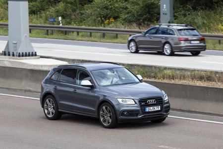 FRANKFURT, GERMANY - JULY 12, 2016: Audi SQ5 SUV on the highway in Germany