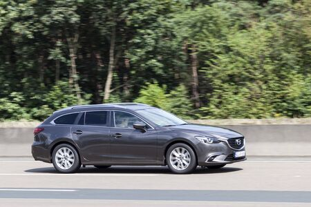 highway 6: FRANKFURT, GERMANY - JULY 12, 2016: Mazda 6 Series Estate large family car on the highway in Germany