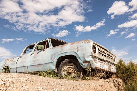 scrapyard: Old abandoned pickup truck in the desert