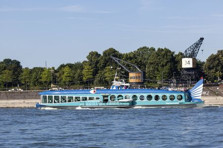 dick: COLOGNE, GERMANY - AUG 7, 2016: Blue cruise ship Moby Dick on the Rhine river in Cologne, Germany Editorial