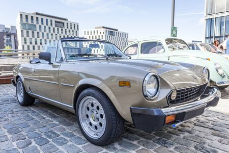 fiat: COLOGNE, GERMANY - AUG 7, 2016: Fiat 124 Spider from ca. 1980 at an exhibition in the city of Cologne, Germany