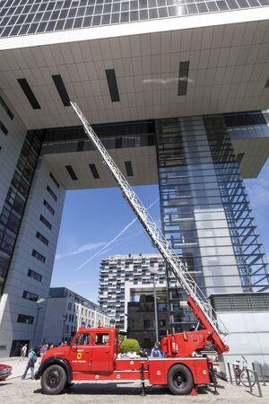 rhine westphalia: COLOGNE, GERMANY - AUG 7, 2016: Historic fire ladder Magirus Deutz truck at the Crane House in Cologne, North Rhine Westphalia, Germany