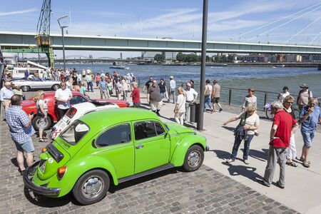 COLOGNE, GERMANY - AUG 7, 2016: Green Volkswagen Beetle at an historic cars exhibition in the city of Cologne, Germany