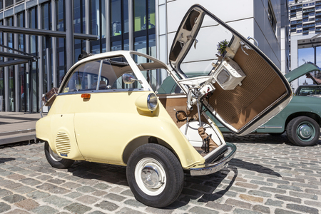 bubble car: COLOGNE, GERMANY - AUG 7, 2016: Historic BMW 300 Isetta bubble car from ca. 1960 at an exhibition in the city of Cologne, Germany