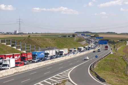 highway traffic: ASCHAFFENBURG, GERMANY - AUG 17, 2016: Trucks stuck on two right lanes because of a traffic jam caused by a construction site Editorial