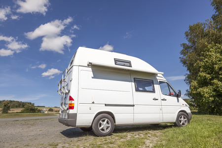 White camper van on a camping site Stock Photo