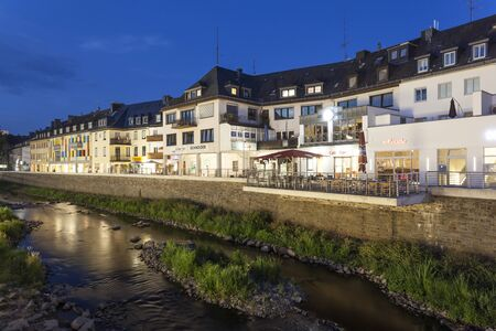 rhine westphalia: SIEGEN, GERMANY - SEP 1, 2016: Waterfront buildings at the Sieg river in the city of Siegen at night. North Rhine Westphalia, Germany Editorial