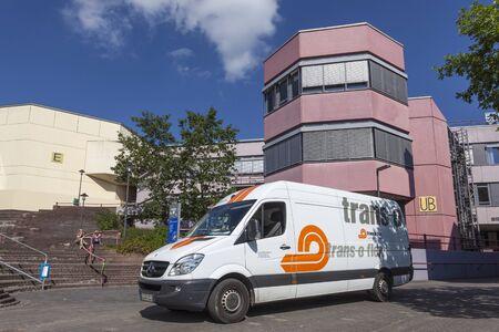 rhine westphalia: SIEGEN, GERMANY - SEP 8, 2016: Trans-o-flex delivery van at the university of Siegen campus. North Rhine Westphalia, Germany
