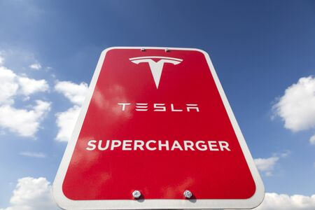 supercharger: WILNSDORF, GERMANY - SEP 1, 2016: Tesla Supercharger station sign. The Supercharger is able to charge a battery from 10 to 80 percent in about 40 minutes