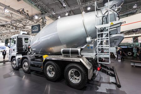 Hannover, Germany - Sep 23, 2016: MAN presents the new concrete mixer truck at the IAA 2016 in Hannover, Germany