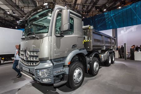 dumper truck: Hannover, Germany - Sep 23, 2016: Mercedes Benz Arocs 4143 K dumper truck at the Commercial Vehicles Fair IAA 2016  in Hannover, Germany Editorial