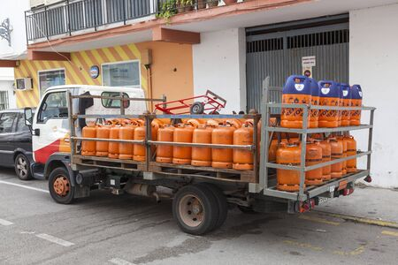 propane: ESTEPONA, SPAIN - OCT 20, 2016: Propane gas bottles delivery truck in the city of Estepona. Costa del Sol, Spain Editorial