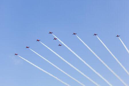 royal air force: ABU DHABI, UAE - NOV 24, 2016: Royal Air Force Aerobatic Team Red Arrows performs in an airshow over the Abu Dhabi Corniche