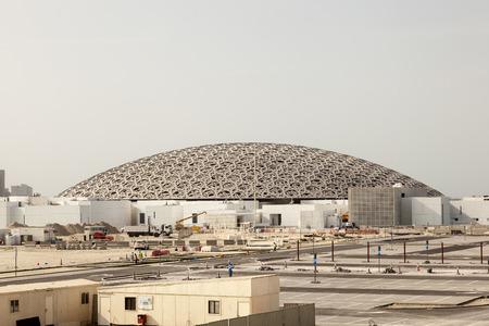 ABU DHABI, UAE - NOV 25, 2016: Construction site of the Louvre Abu Dhabi museum on the Saadiyat Island Cultural District