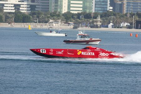 bateau de course: ABU DHABI, UAE - NOV 24, 2016: Red racing boat at the Powerboat Championship 2016 in Abu Dhabi, United Arab Emirates Éditoriale