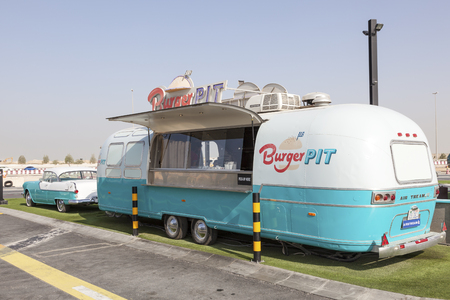 airstream: DUBAI, UAE - NOV 27, 2016: Airstream caravan food truck at the Last Exit food trucks park on the E11 highway between Abu Dhabi and Dubai