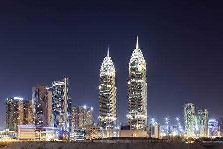 Skyscrapers at the Dubai Internet City illuminated at night. United Arab Emirates, Middle East Editorial