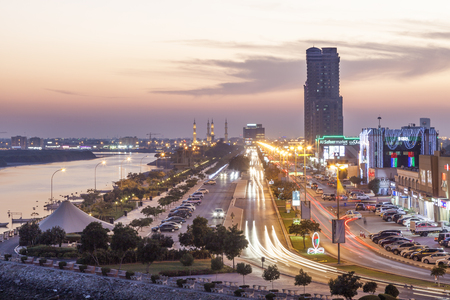 RAS AL KHAIMAH, UAE - NOV 30, 2016: Ras al Khaimah creek and corniche illuminated at night. United Arab Emirates, Middle East