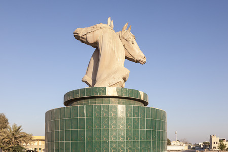 Horses statue in a roundabout in Umm Al Quwain. United Arab Emirates, Middle East