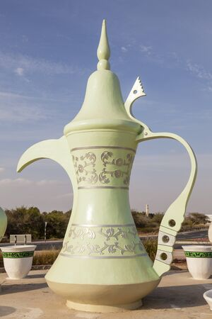 Traditional arabic coffee pot in a roundabout in Al Ain. Emirate of Abu Dhabi, United Arab Emirates