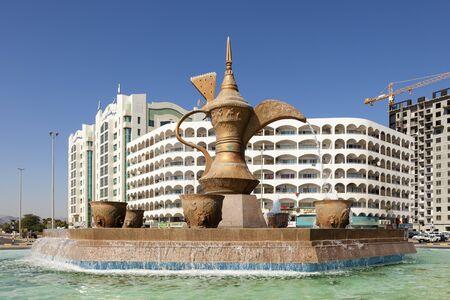 FUJAIRAH, UAE - DEC 1, 2016: Arabian coffeepot fountain monument in the city of Fujairah, United Arab Emirates