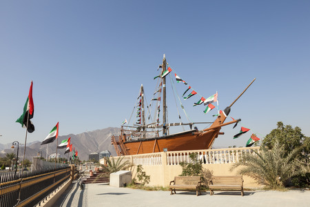 Historic dhow ship at the corniche in Khorfakkan, United Arab Emirates