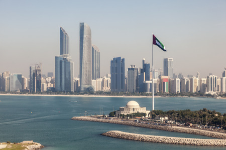 Elevated view of Abu Dhabi downtown skyline and corniche with the flag pole. United Arab Emirates, Middle East Stock Photo