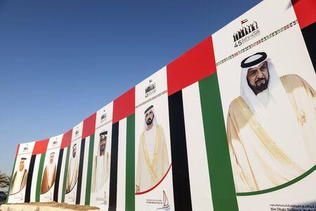 ABU DHABI, UAE - DEC 3, 2016: Billboard with portraits of the UAE rulers and sheikhs in the city of Abu Dhabi, United Arab Emirates Editorial