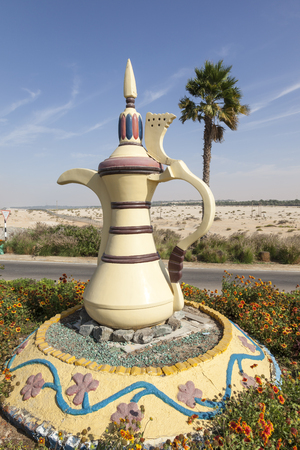 Traditional arabian coffeepot monument in the desert town Mezairaa, Emirate of Abu Dhabi, United Arab Emirates