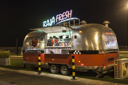 airstream: DUBAI, UAE - DEC 4, 2016: Airstream caravan food truck at the Last Exit food trucks park on the E11 highway between Abu Dhabi and Dubai
