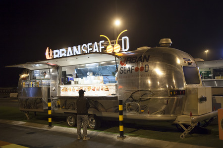 airstream: DUBAI, UAE - DEC 4, 2016: Airstream caravan food truck Urban Seafood at the Last Exit food trucks park on the E11 highway between Abu Dhabi and Dubai Editorial