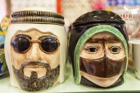 Heads of male and female arabs in traditional dress. Dubai, United Arab Emirates