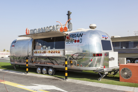 airstream: DUBAI, UAE - NOV 27, 2016: Airstream caravan converted to the Urgan Seafood truck at the Last Exit food trucks park on the E11 highway between Abu Dhabi and Dubai Editorial