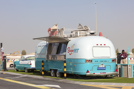 airstream: DUBAI, UAE - NOV 27, 2016: Airstream caravan converted to a food truck at the Last Exit food trucks park on the E11 highway between Abu Dhabi and Dubai