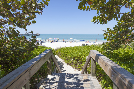 Naples, Fl, USA - March 18, 2017: Access path to the beautiful white sand beach in Naples. Florida, United States Editorial