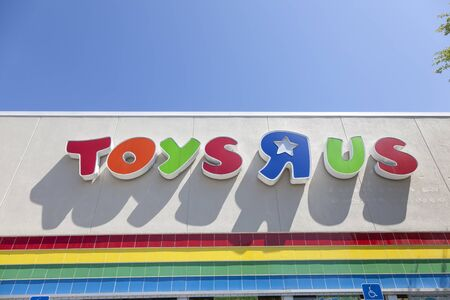 Naples, Fl, USA - March 19, 2017: Toys R Us corporate logo on a branch store in the city of Naples. Florida, United States