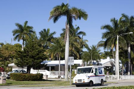 Hollywood, Fl, USA - March 21, 2017: United States Postal Service (USPS) truck delivering in a residential neighborhood in Hollywood. Florida, United States