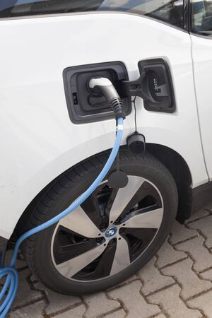 i3: Frankfurt, Germany - March 30, 2017: BMW i3 electric vehicle at a charging station Editorial
