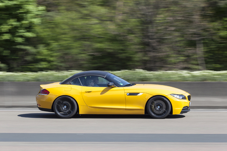 Frankfurt, Germany - March 30, 2017: Yellow BMW sports car on the highway in Germany Editorial